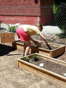 Myka using her box garden